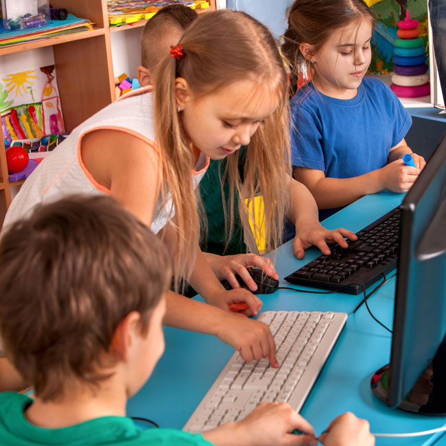 Kids Playing with Computers