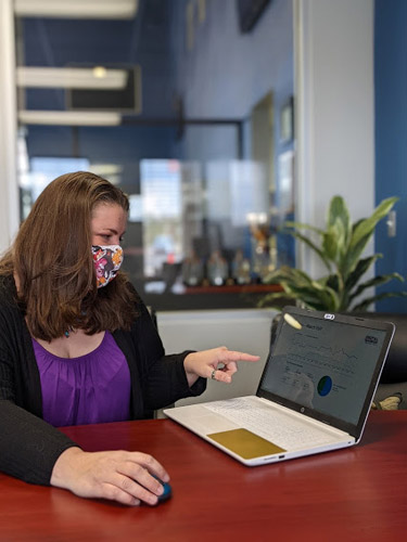 Woman pointing to Google Analytics on her laptop
